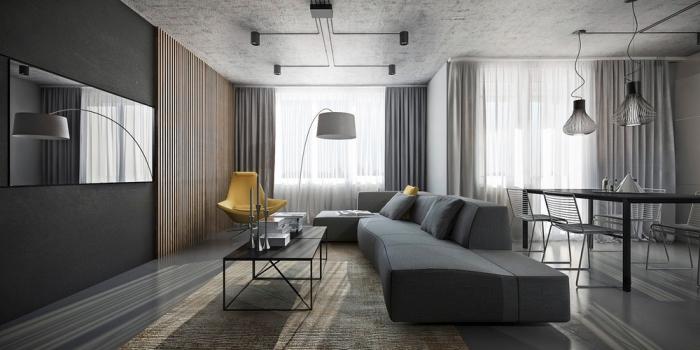 exemple de déco moderne dans un salon en gris foncé avec tapis beige et pan de mur en bois marron, modèle de chaise fauteuil jaune
