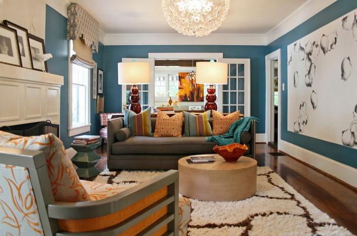 décorer son salon de façon tendance, fauteuil géant et canapé gris, tapis berbère, sofa gris, coussins déco, manteau cheminée blanc