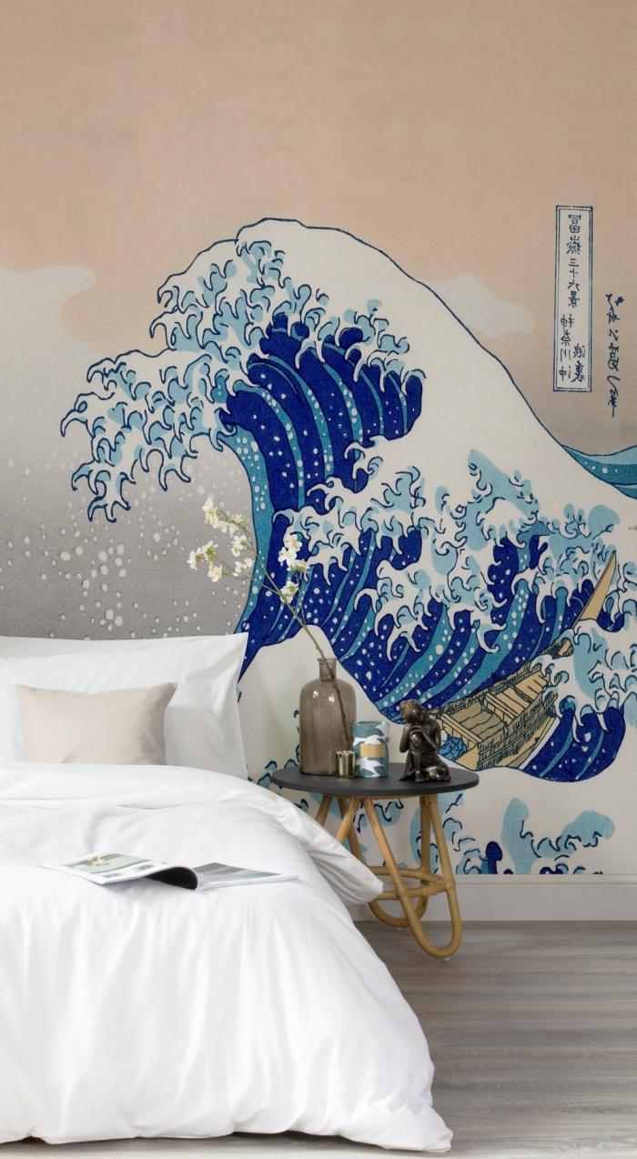 ambiance moderne dans la chambre à coucher avec une tête de lit en papier peint à motif la grande vague de kanagawa