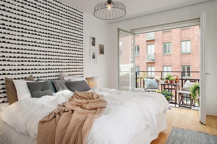 faire une tete de lit originale en posant du papier peint graphique tendance sur un pan de mur pour créer une ambiance scandinave moderne