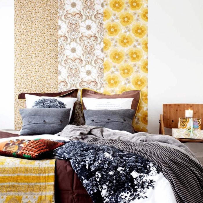 idées déco tête de lit originale réalisée avec des chutes de papier dépareillées collées derrière le lit