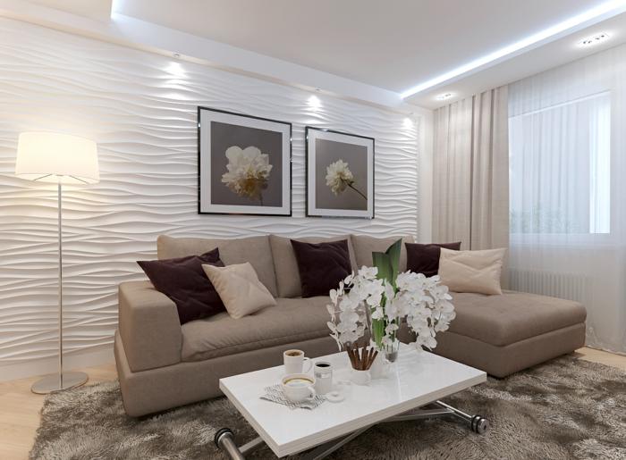 tapis moelleux, table basse pliante, sofa beige, coussins déco simples et panneaux muraux blancs, tableaux avec peintures