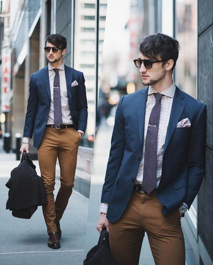 vetement homme stylé avec veste bleu nuit et pantalon marron, cravate bleue, chemise blanche a carreaux beiges, look de bureau