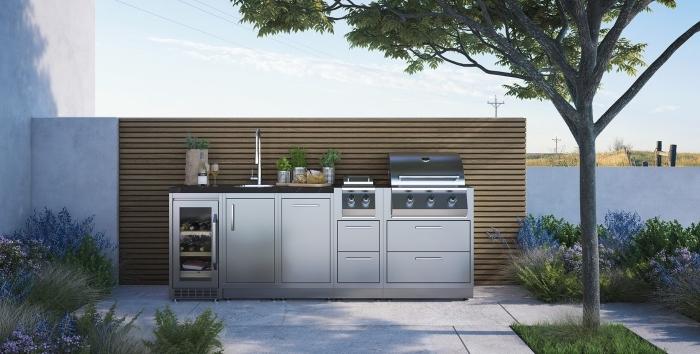 design moderne d'une cuisine de jardin avec modules en inox et plan de travail en granit, modèle d'évier extérieur