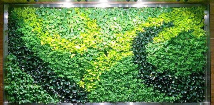 culture verticale avec plusieurs nuances du vert et du jaune, motifs spirales et ondes, tapis mural intérieur, grand panneau rectangulaire vert calmant