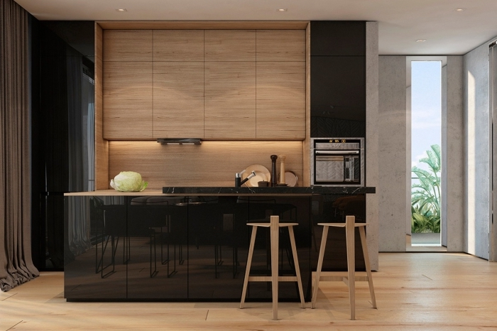 modele de cuisine moderne en meubles de bois sans poignées et ilot central bois et noir laqué, exemple éclairage sous meuble