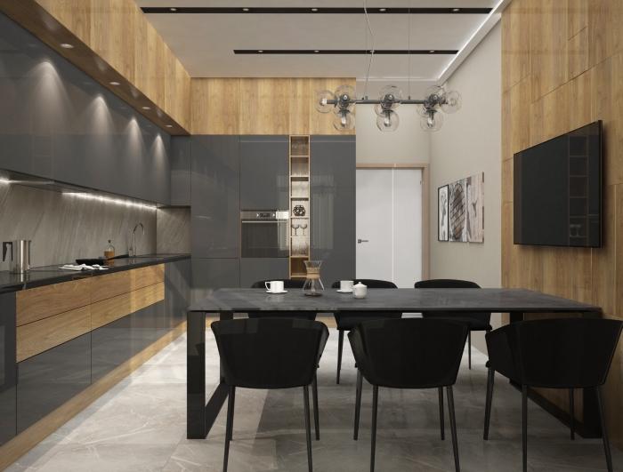 aménagement cuisine gris anthracite et bois au plafond suspendu blanc et carrelage sol en gris clair avec revêtement partiel en bois