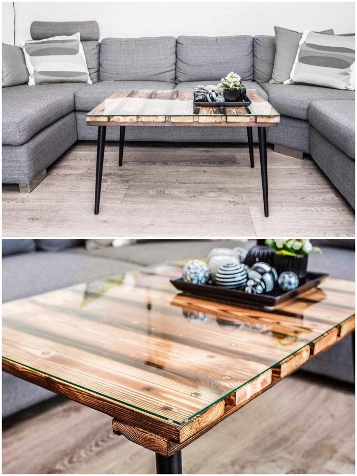 table basse originale au look vintage et minimaliste avec un plateau à lattes laquée et des pieds obliques noir