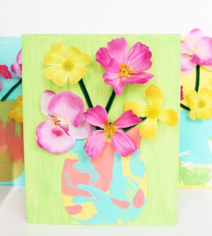 toile repeinte en vert avec un vase en papier coloré de peinture, fleurs et tiges en cure pipe effet 3d, idee cadeau maitresse maternelle