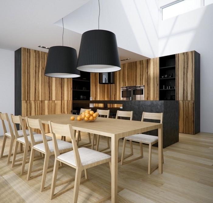 modèle de salle à manger dans une cuisine ouverte moderne aux murs et plafond blanc équipée de meubles bois foncé et noir
