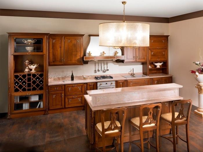 idée décoration de cuisine avec meubles de bois marron foncé et ilot central, pièce aux murs beige et plafond blanc
