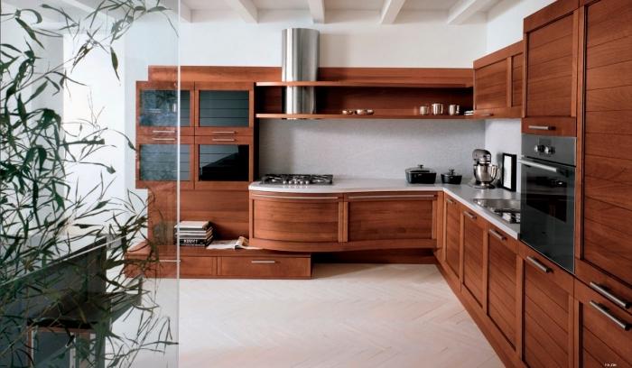 design intérieur dans une cuisine aménagée en L avec meubles de bois foncé et comptoir blanc, idée plantes intérieur