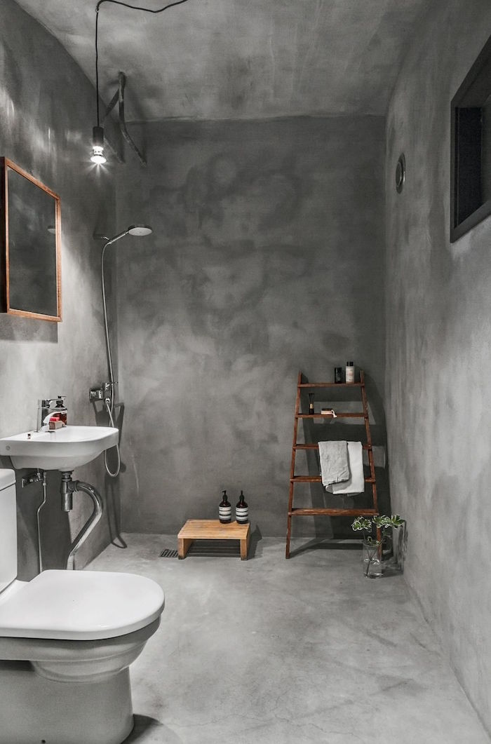 photo de rénovation salle de bain avec sol plafond et mur en béton ciré gris