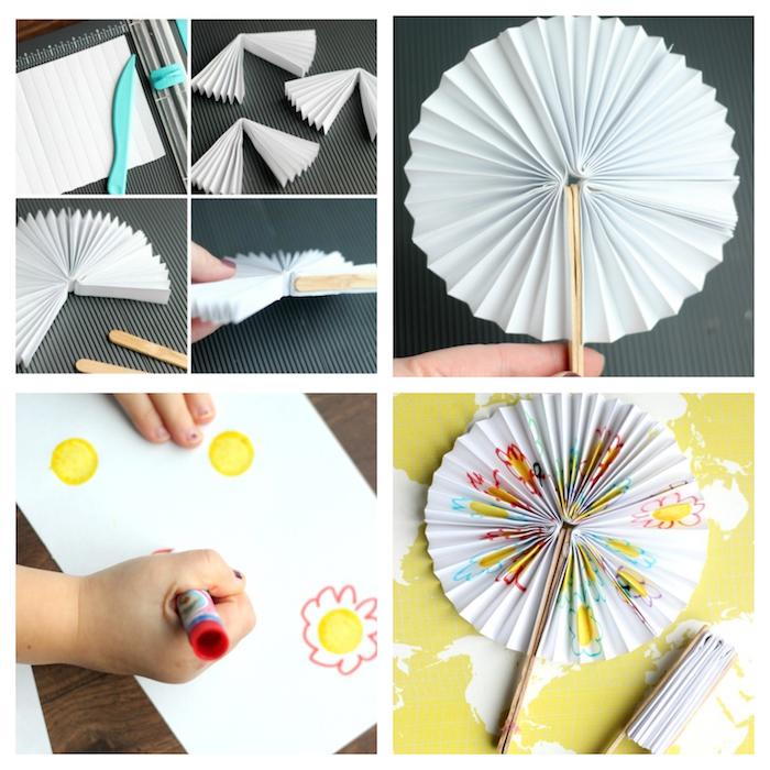idée pour fabriquer un éventail en papier blanc décoré à motifs dessin enfant et des batonnets de glace pour manche