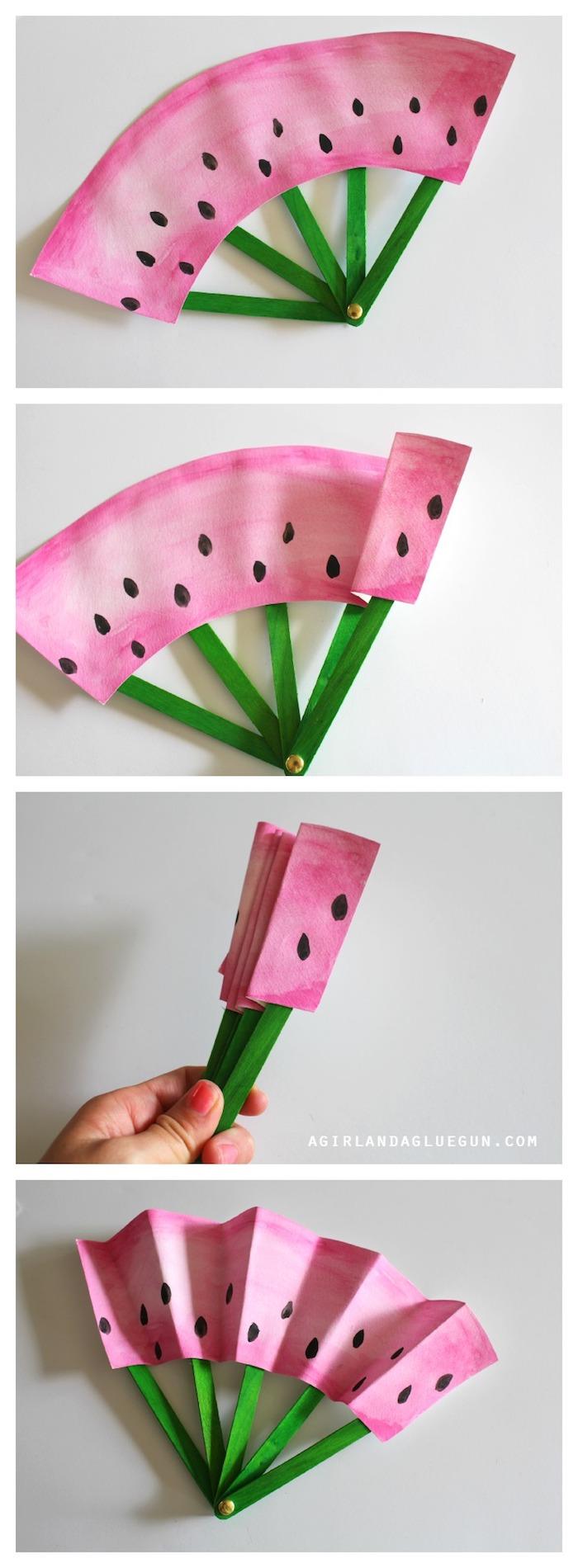 activité manuelle primaire, eventail japonais en papier et batonnets de glace et papier repeint en rose avec touches de peinture imitations pépins