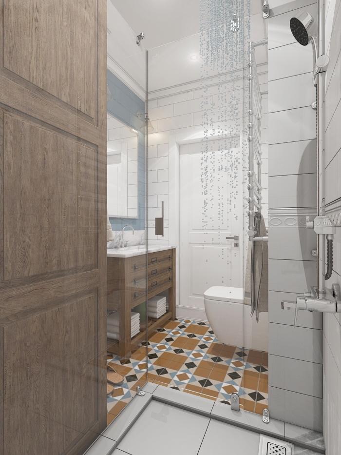 salle de bain tendance petit espace aux murs en carrelage blanc avec meuble sous vasque de bois foncé et comptoir blanc