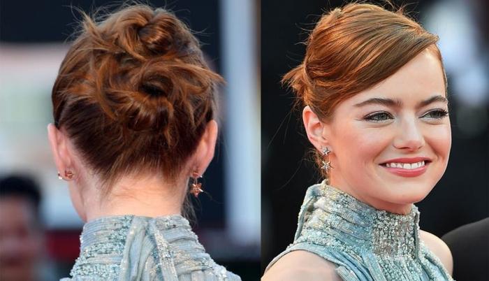 Emma Stone avec des cheveux acajou, deux petits buns messy avec la frange de côté