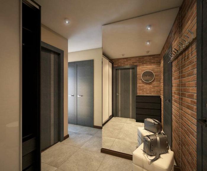 décoration couleur wengé, dalles de sol gris clairs, grand miroir, mur en briques