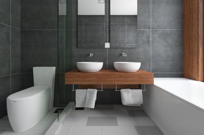 modele carrelage salle de bain gris anthracite sur les murs combiné avec dalles de sol en blanc et gris clair