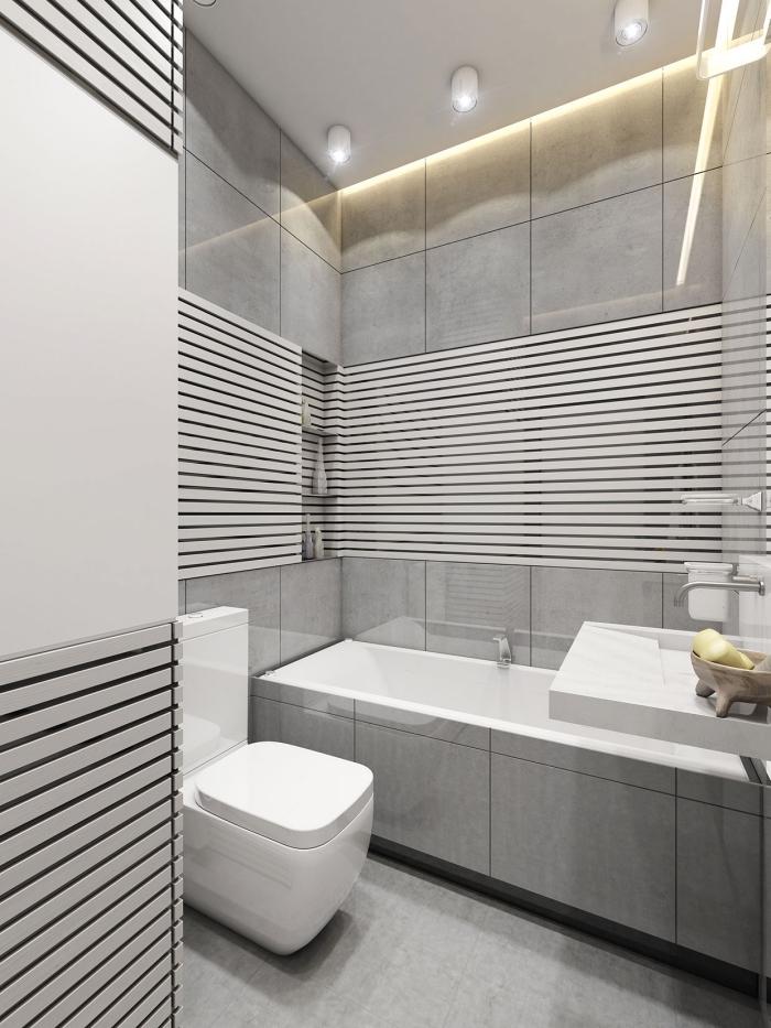 modèle salle de bain gris et blanc avec plafond suspendu et panneaux d habillage pour rénover sa salle de bains à niches pour accessoires