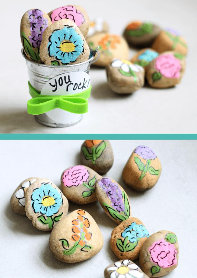 galets décorés à motifs fleurs dessinés dans un seau décoratif miniature, cadeau pour sa meilleure amie diy