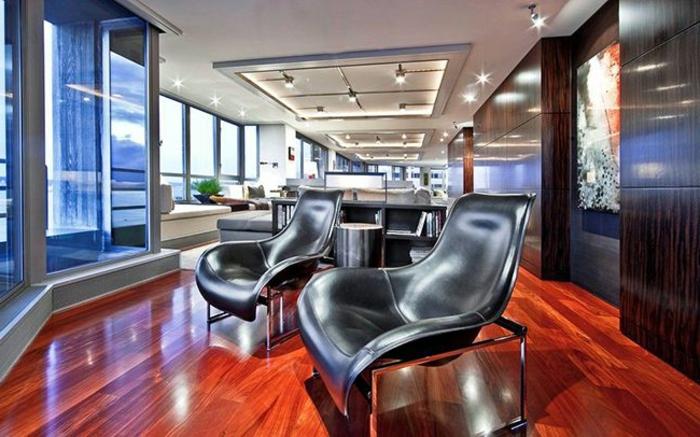 grand salon en bois, noir et gris, meuble wengé, faux plafond lumineux, fenêtres panoramique