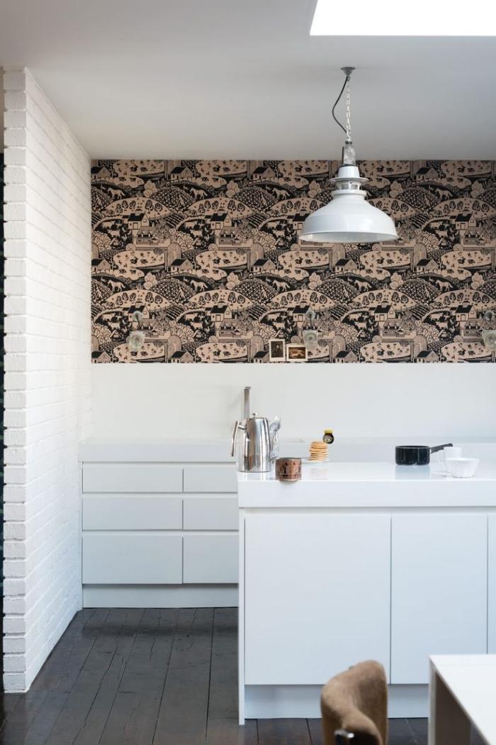 cuisine blanche au design épuré et minimaliste réveillée par du papier peint deco tendance à motif paysage posé en haut du mur