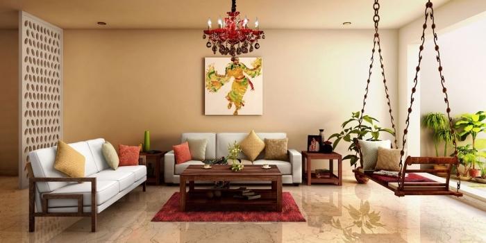 intérieur de style chic ethnique dans un salon beige aménagé avec canapés et balançoire exotique couverte de coussins