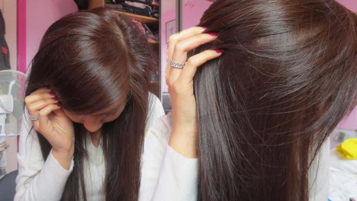 exemple de coloration chocolat glacé pour cheveux longs jeune femme