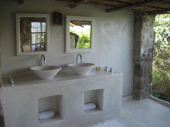 exemple de meuble salle de bain beton comme support lavabo et murs en ciment