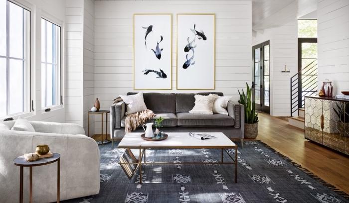 exemple de pièce blanche aménagée de style moderne et traditionnel, modèle de canapé en velours gris anthracite