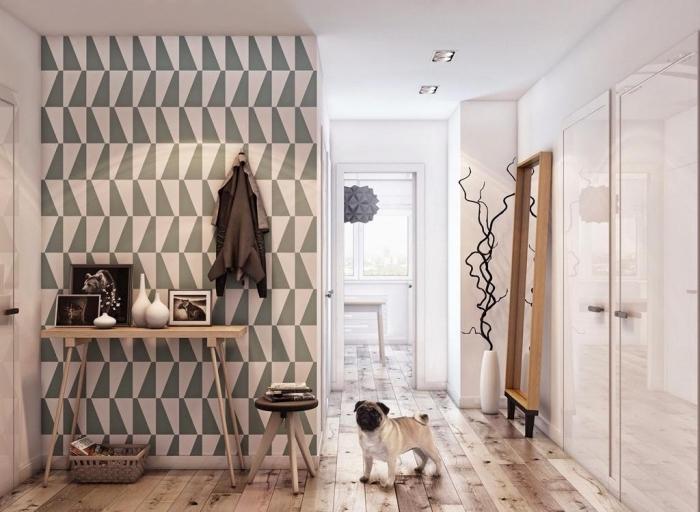 déco entrée scandinave avec du papier peint moderne à motif graphique gris et blanc qui met en valeur la console