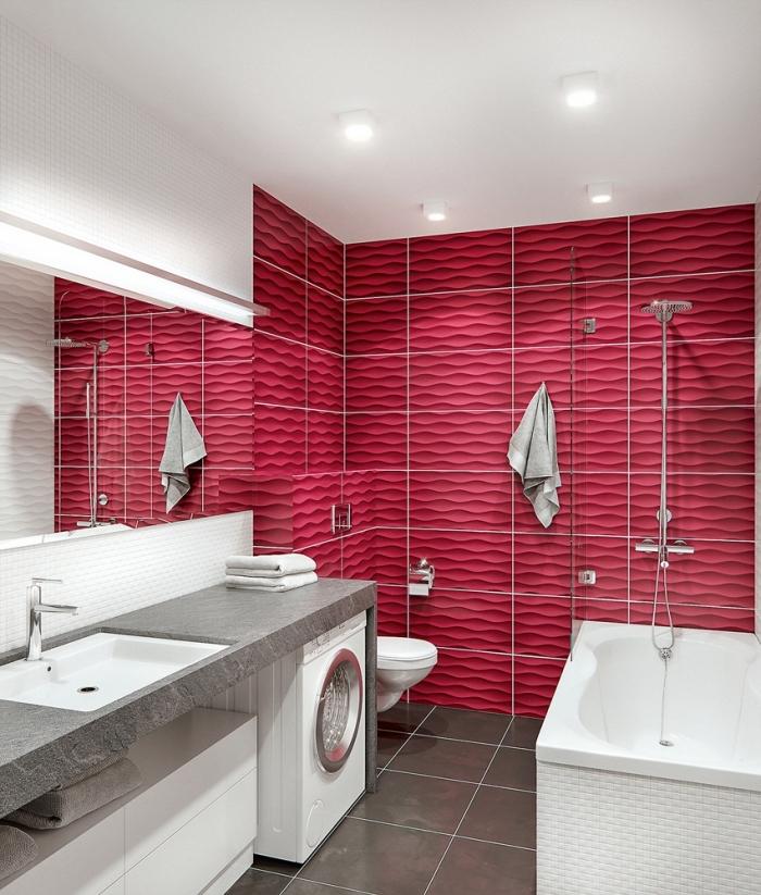meuble petite salle de bain sous vasque sans poignée avec comptoir gris, revêtement mural en carrelage rose