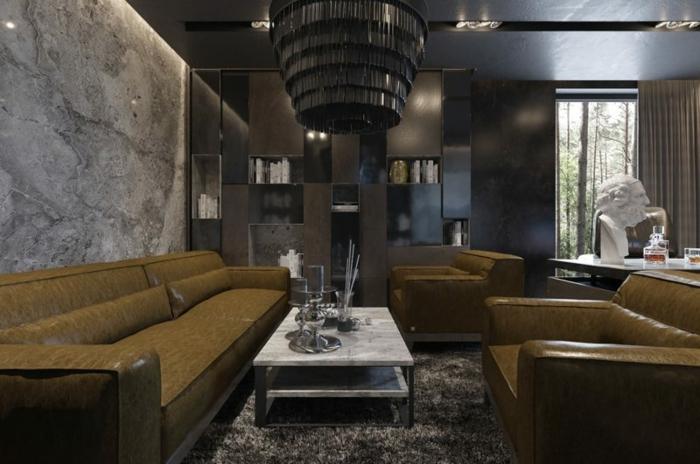 grands canapés couleur olive, table basse marbrée, plafonnier géant, tapis moelleux gris, mur effet marbre