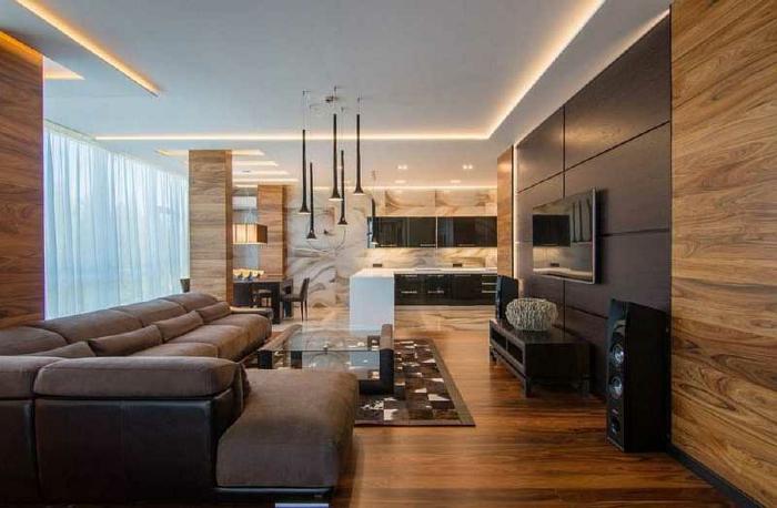association meuble marron, grand canapé wengé, sol en bois, tapis patchwork, panneau mural wengé couleur