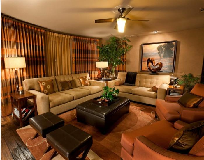 salon avec meule wengé, table pouf wengé, tabourets couleur wengé, canapés beiges