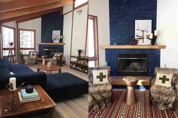 un coin cheminée peint en couleur bleu nuit en contraste avec la déco boisée et les murs blancs du salon ethnique chic