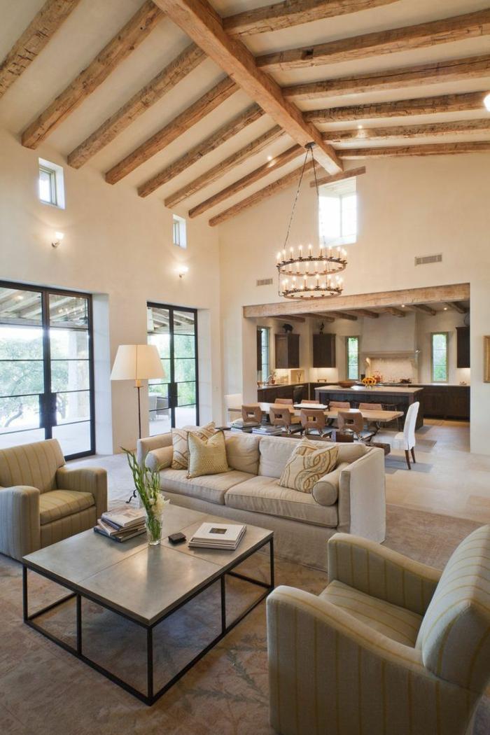 aménagement cuisine americaine, intérieur style loft, poutres en bois brut, grand chandelier