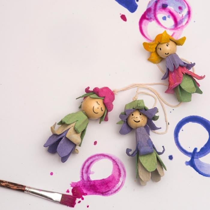 idée originale pour une activité manuelle primaire avec des matériaux recyclés, des poupées en boîte à oeufs et perles de bois