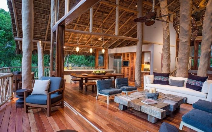 exemple comment aménager une villa exotique avec meubles de bois et colonnes poutres de bois apparentes