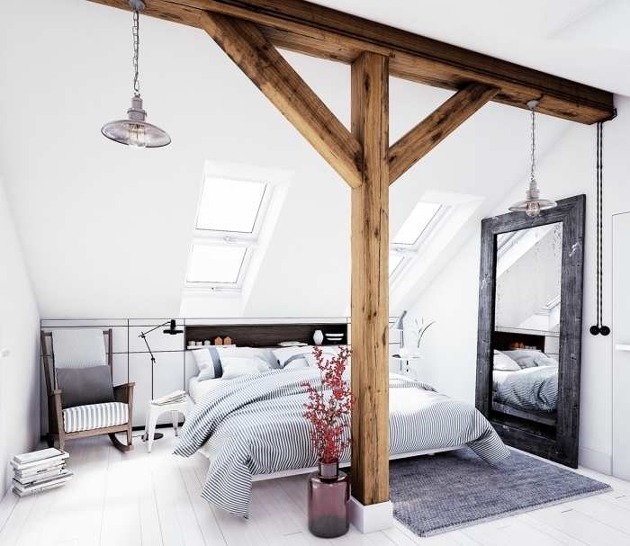 comment décorer une chambre adulte dans l'esprit scandinave avec grand lit et meubles de bois foncé, idée déco avec charpente de bois apparente