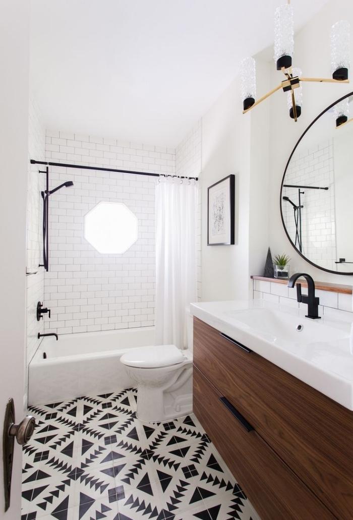 idée déco de salle de bain en blanc et noir avec meuble bois foncé, modèle de miroir rond à cadre noir mate