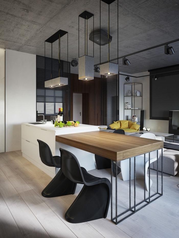 implantation cuisine avec un ilot central table en bois et métal intégrée dans le plan de travail blanc , aménagée dans une cuisine d'esprit loft industriel