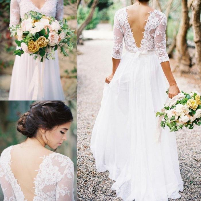 une robe de mariée bohème chic qui met accent sur le dos de la mariée avec son décolleté plongeant et son petit détail mignon à la taille en forme de noeud