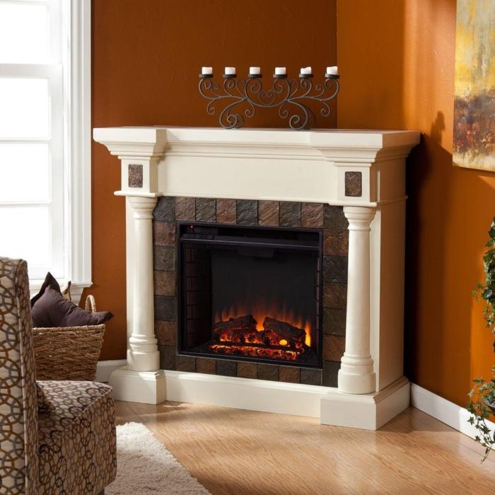grand bougeoir design ancien, cheminée murale blanche, mur orange, fausse cheminée décorative