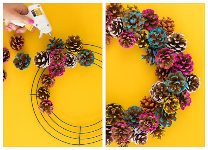 comment faire une couronne de pommes de pin colorées de peinture jaune, rose, blanche et bleue sur un cerceau en fils de fer