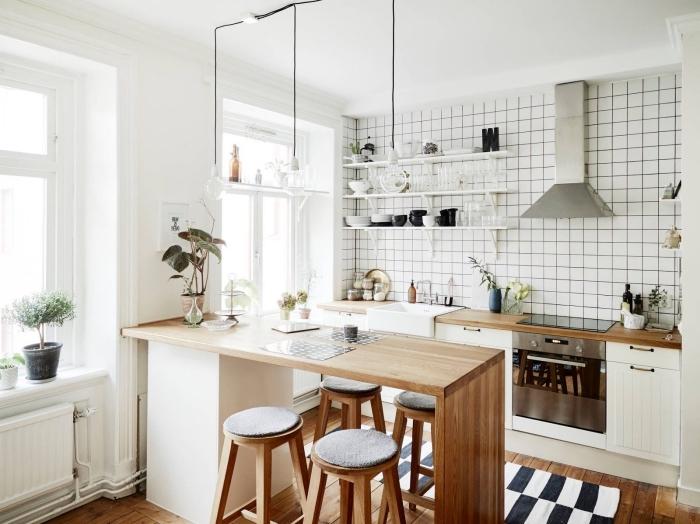 idée d'aménagement d'un ilot central dans une petite cuisine scandinave en blanc et bois, ilot central minimaliste en bois qui joue le rôle d'un comptoir et d'un coin bar