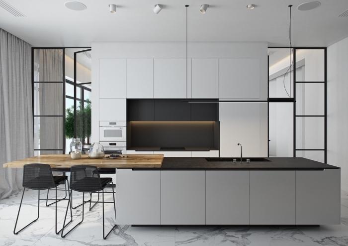 cuisine moderne en gris aux accents noir, avec des armoires à finition mat, ilot central avec table en bois intégrée et zone de lavage