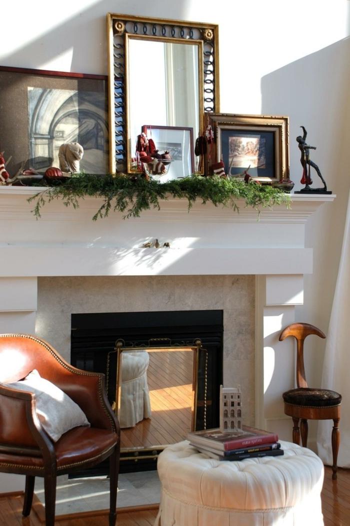 deco cheminee blanche, fauteuil en cuir, petite chaise à assise ronde, miroir, cadres peintures
