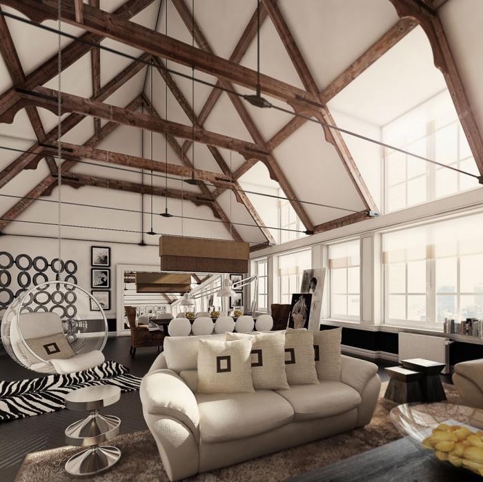 salon moderne avec plafond haut en poutres foncées apparentes avec meubles blanc et noir, idée déco cocooning avec chaise suspendue